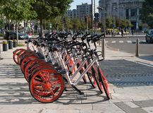 Milan, Italy - 10 May 2018: Mobike Bike Sharing Service Row of Bikes on the square in front of the Central Railway stock photos