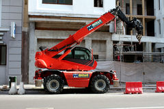 MILAN, ITALY-MAY 25, 2015: Parked red Construction Crane on building site Stock Photo