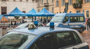 Police car parked in the street during a control operation. Milan, Italy - November 5, 2017: Police car parked in the street during a control operation in front stock photos