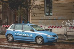 Police car parked in the street during a control operation. Milan, Italy - November 5, 2017: Police car parked in the street during a control operation in front royalty free stock photo