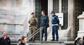 Soldiers monitor and control tourists at the entrance of Milan C. Milan, Italy - November 03, 2017 : soldiers monitor and control tourists at the entrance of royalty free stock image