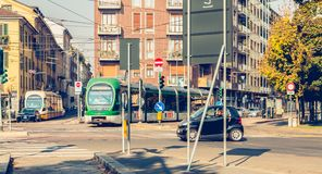 Two tramway company Azienda Trasporti Milanesi stopped at a junc. MILAN, ITALY - November 03, 2017 : two tramway company Azienda Trasporti Milanesi stopped at a Stock Photos