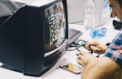 Milan ITALY OCT 2018 - Peoples playing with vintage video game at the Games week in Milano (Rho fiera). stock photo