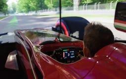 Milan , ITALY - OCT 2018 Public race car Simulator on Ferrari F1 at 2018 - Games week royalty free stock photos