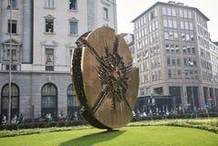 Disco by Arnaldo Pomodoro. Milan, Italy - October 11, 2017: Disco, golden statue, designed by Arnaldo Pomodoro Stock Photography