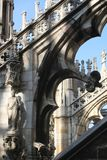 The sculptural decoration and a flying buttresses of the Milan Cathedral. Milan, Italy - OCTOBER 24, 2015: High Gothic. Masterly decoration and sculptural stock images