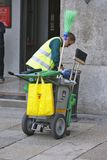 Milan, Italy - City Cleaning Service. MILAN, ITALY - OCTOBER 03: A member of the municipal cleaning service performs his activity in Milan, Italy on October 03 Stock Photo