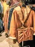 Shot vintage coats at a stand royalty free stock photos