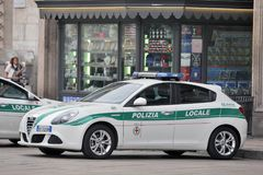 Milan, Italy - Local Police. Milan, Italy - October 03: On the squere ``Piazza del Duomo``, the central squere of Milan, patrolling local police cars to ready Stock Image