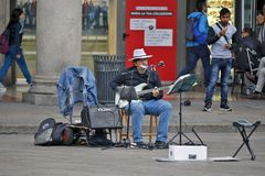 Milan, Italy - Artist - Musician on the squere Piazza del Duomo. Milan, Italy - October 03: On the squere ``Piazza del Duomo``, the central squere of Milan, are Royalty Free Stock Image