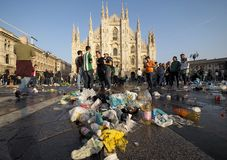 MILAN, Italy: 25 October 2018: Wastes in Duomo square, Milan, Lombardy. Supporter Betis Siviglia dirty Duomo square of waste before Europa league match against stock image