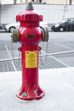 MILAN, ITALY OCTOBRE 20, 2015: New red water pump for fire fighting, fire hydrant in the city.  Royalty Free Stock Images
