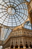 Milan, Italy. Ornate glass ceiling in Vittorio Emanuele gallery. Low angle view of ornate glass ceiling in Vittorio Emanuele gallery - is an historic shopping Royalty Free Stock Images