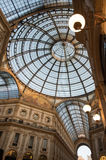 Milan, Italy. Ornate glass ceiling in Vittorio Emanuele gallery. Low angle view of ornate glass ceiling in Vittorio Emanuele gallery - is an historic shopping Royalty Free Stock Photo