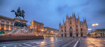 Milan, Italy: Piazza del Duomo, Cathedral Square in the sunrise. Monument to King Victor Emmanuel II Royalty Free Stock Images
