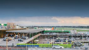 Entrance to Milan Linate, which services short and medium-range destinations in Europe and is Alitalia`s hub. Milan, Italy - Sept 17, 2017: Entrance to Milan Stock Photography