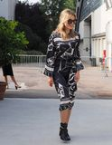MILAN, Italy: 19 september 2018: Fashionable woman in streetstyle outfit. Fashionable woman in streetstyle outfit after Alberto Zambelli fashion show during royalty free stock image