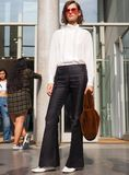 MILAN, Italy: September 22, 2018:Fashionable woman streetstyle outfit. Fashionable woman streetstyle outfit after Philosophy di Lorenzo Serafini fashion show stock photography