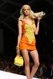 MILAN, ITALY - SEPTEMBER 18: A model walks the runway during the Moschino show Stock Photos