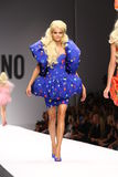 MILAN, ITALY - SEPTEMBER 18: A model walks the runway during the Moschino show Stock Image