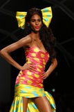 MILAN, ITALY - SEPTEMBER 18: A model walks the runway during the Moschino show Stock Photography