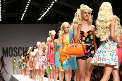 MILAN, ITALY - SEPTEMBER 18: Models walk the runway finale during the Moschino show Stock Photography