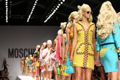 MILAN, ITALY - SEPTEMBER 18: Models walk the runway finale during the Moschino show Stock Photos