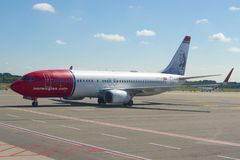 Norwegian Air Shuttle Boeing 737-8JP LN-DYD with Hans Christian Andersen`s portrait on the taxiway of Malpensa Airport Royalty Free Stock Images