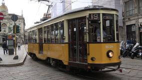 Old yellow tram on a city street. Milan, Italy stock footage