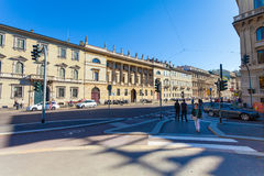 MILAN, ITALY - September 06, 2016: Pedestrians are waiting the green light of traffic light  on  crossroad on Avenue Buenos Aires Royalty Free Stock Photos
