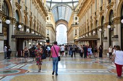MILAN, ITALY - SEPTEMBER 7, 2017: people walking inside the Vittorio Emanuele II Gallery in Milan, Italy Stock Photo