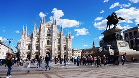 MILAN, ITALY - SEPTEMBER 12, 2017: Piazza del Duomo square with tourists sunny day with sky blue e white clouds, Milan, Italy Stock Photography