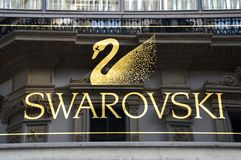 MILAN, ITALY - SEPTEMBER 7, 2017: signboard of Swarovski store inside of Galleria Vittorio Emanuele II, Milan, Italy royalty free stock photo