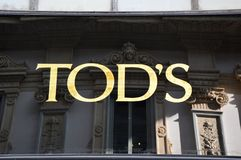 MILAN, ITALY - SEPTEMBER 7, 2017: Tod`s store sign, is an Italian company which produces luxury shoes and other leather goods, Ga royalty free stock photo