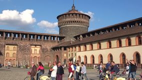 Tourists in the Sforza castle on a sunny day. Milan stock video