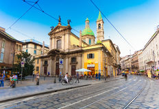 MILAN, ITALY - September 07, 2016: View on the Saint George Church Chiesa San Giorgio al Palazzo, people and cobbled Torino stre. View on the Saint George Church Royalty Free Stock Image