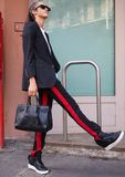 MILAN, Italy: 19 september 2018: Woman streetstyle outfit after BYBLOS fashion show. Woman streetstyle outfit after BYBLOS fashion show during Milan fashion week royalty free stock image