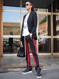 MILAN, Italy: 19 september 2018: Woman streetstyle outfit after BYBLOS fashion show. Woman streetstyle outfit after BYBLOS fashion show during Milan fashion week stock photos