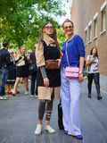 MILAN, Italy, 20 septembre 2018: Women posing for photographers in the street before FENDI royalty free stock photo