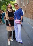 MILAN, Italy, 20 septembre 2018: Women posing for photographers in the street before FENDI stock image