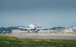 British Airways commercial airplane lands at Milan`s Linate airport. Linate is a main hub for Alitalia servicing many short and m. Milan, Italy. 10th July, 2017 Royalty Free Stock Photos