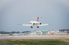 A meridiana airliner commercial airplane lands at Milan`s Linate airport. Linate is a main hub for Alitalia servicing many short. Milan, Italy. 10th July, 2017 Royalty Free Stock Image