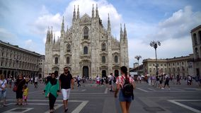Milan, Italy - 14.08.2018: Tourists visiting the Piazza Duomo square in Milan.