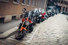 MILAN, LOMBARDIA, ITALY - FEBRUARY 07, 2017: Motorbikes parked i Stock Photos
