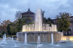 Castello Sforzesco and fountain at evening in Milan Stock Image