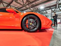 Milan, Lombardy Italy - November 23 , 2018 - Visitors of Autoclassica Milano 2018 edition take photos at Ferrari 458 stock photo