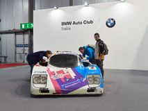 Milan, Lombardy Italy - November 23 , 2018 - Visitors of Autoclassica Milano 2018 inspect a BMW racing car royalty free stock photography