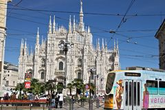 Piazza del Duomo in Milan with people and trams. The facade of t stock images