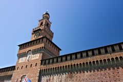 Sforza Castle in Milan. Tower with clock. The tower that overlooks the entrance to the walls of the castle of Milano. Milan, Lombardy, Italy, 04/27/2019. Sforza stock images