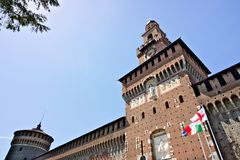 Sforza Castle in Milan. Tower with clock. The tower that overlooks the entrance to the walls of the castle of Milano. Milan, Lombardy, Italy, 04/27/2019. Sforza royalty free stock photography